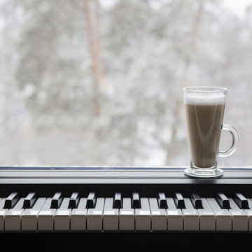 electronic piano in the interior near the window
