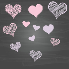 Scribble hearts on chalkboard
