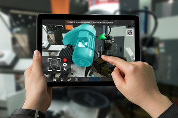 Industrial 4.0 , Augmented reality concept. Hand holding tablet with AR service , maintenance application and calling technician for check destroy part of smart machine motor in smart factory Wall mural