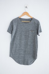 Grey t-shirt hanging on wall