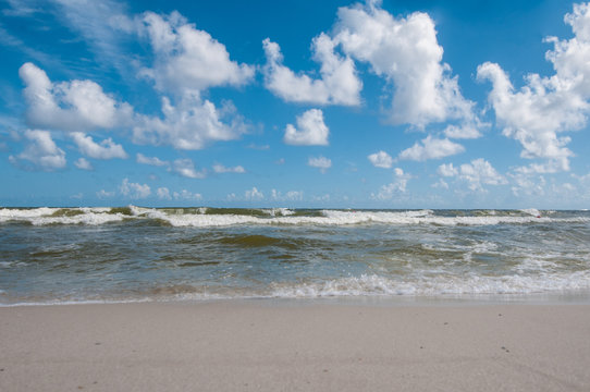 Blue sky and waves on beach at Gulf Shores Alabama