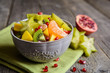 Juicy fruit salad with kiwi, mango, mandarin, carambola and pomegranate