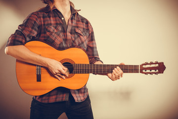 Male hands with guitar