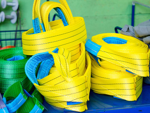 Colorful nylon soft lifting slings stacked in piles