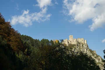 Castle on the rock in colorful woods during autumn. Slovakia