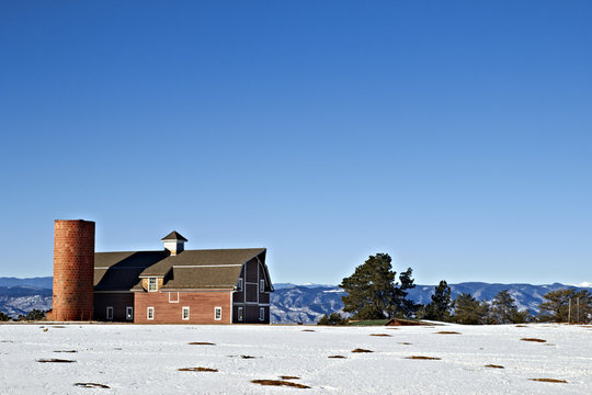 Old Barn on top of a Snow Covered Mountain