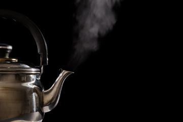 Foto auf Leinwand Musik Closeup of steam from boiling teapot on black background