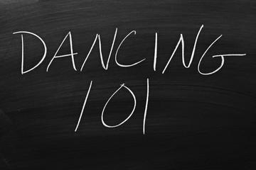 """The words """"Dancing 101"""" on a blackboard in chalk"""