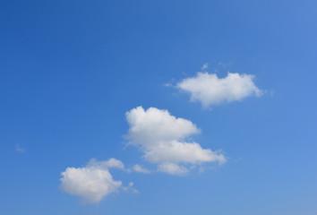 Clouds on the blue sky. Heart shape