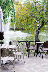 pair of tables by the lake,