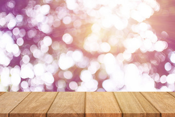 Empty wooden table top and sunny blurred bokeh background for product displa