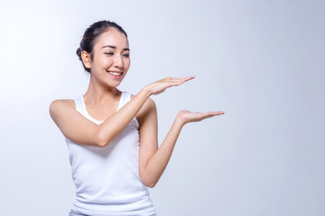 Beauty Woman face Portrait, girl points by hand, girl showing pr