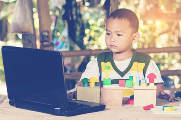 Young boy learning on laptop computer concept for education, lea