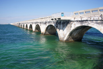 Old historical seven mile bridge, connected Florida Keys over turquoise caribbean water. The bridge allowed for pedestrians in some areas.