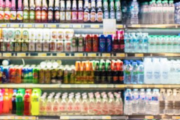 Defocused blur of supermarket shelves with Bottles of Beverages