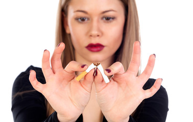 Attractive young woman breaking a cigar