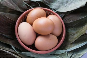 eggs on dry banana background
