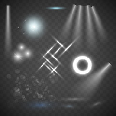 Glowing lights, stars and sparkles. Isolated on transparent background. Scene illumination, transparent effects on a plaid dark background. Bright lighting with spotlights.