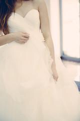 Bride white wedding dress, shallow focus, tulle cloth vertical, vintage