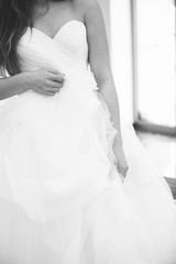 Bride white wedding dress, shallow focus, tulle cloth vertical, black and white
