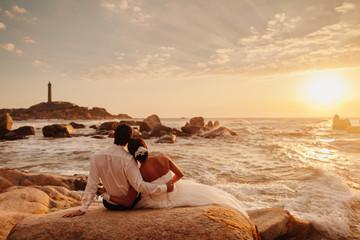 honeymoon couple relax on sunset beach