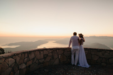 honeymoon couple travel mountains and sea view