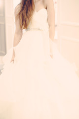 Wedding bridal white dress in the showroom fashion, abstract, vintage verticle