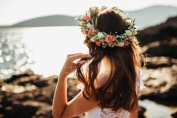 woman in bridal wreath on beach
