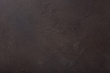 Rusty brown concrete stone background texture. Horizontal.
