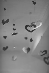 Heart decor shapes hanging from ceiling, vertical , creative