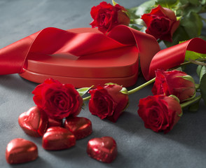 Heart shaped box with red hearts roses and ribbon