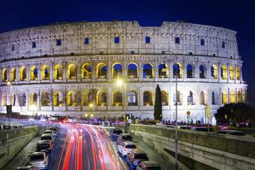 Colosseum lit at night.