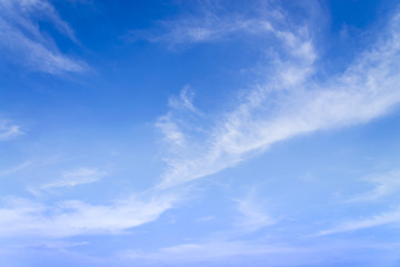 Blue sky with closeup white fluffy tiny clouds background and pa