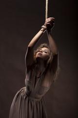 Beautiful young girl dancing with blue fabric