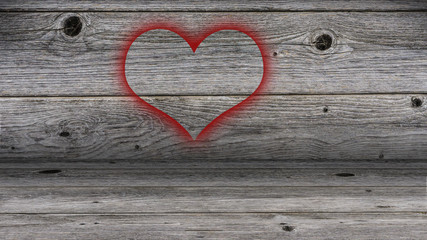 sprayed heart on a wooden wall