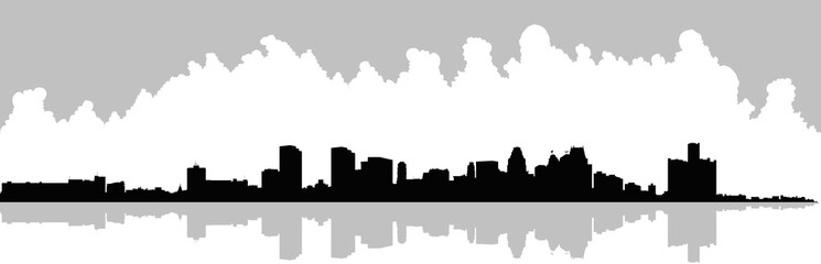 Wide skyline silhouette of the downtown of the city of Detroit, Michigan, USA.