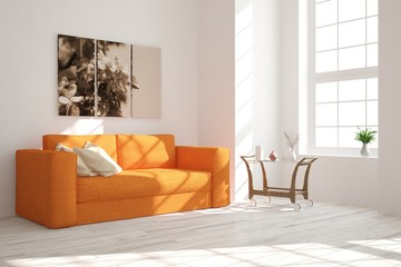 Modern interior design with orange sofa