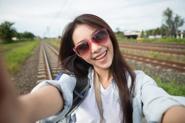 Young beautiful Asia woman photo selfie, asian beauty,travel concept