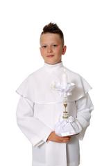 Obraz Pierwsza Komunia Święta, chłopiec na białym tle. - fototapety do salonu