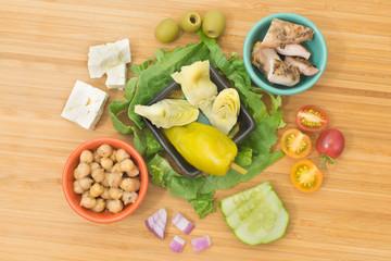 Greek Salad with Chicken & Artichoke Hearts ingredients, overhead view