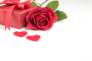 Red rose with gift box and two hearts