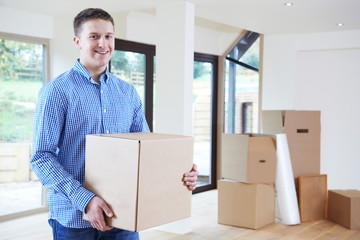 Young Man Moving Into New Home