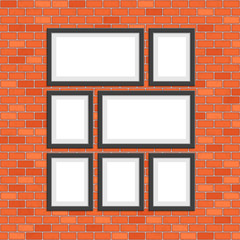 Picture photo frames on red bricks wall.