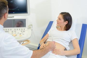Lady having pregnancy scan