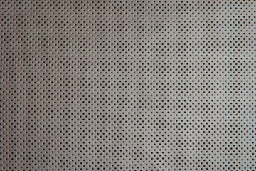 White beige perforated leather texture background
