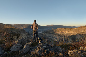 Alone man stands above the canyon. Mountain landscape with the