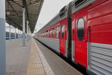 Passenger train on the platform of railway station