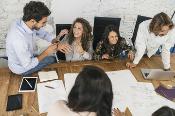 Young team of coworkers doing a brainstorming in a modern studio