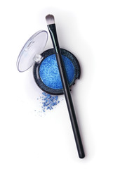 Blue pearlescent eyeshadow and brush for makeup