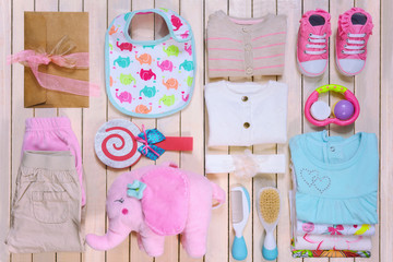 Baby fashion. Trendy female clothes and kit. Top view.